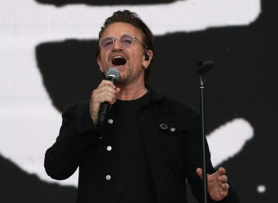 There's Bono now, singing in Canada.