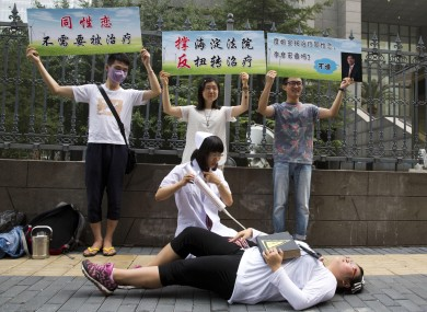 Gay rights campaigners act out electric shock treatment to protest so-called conversion therapy.