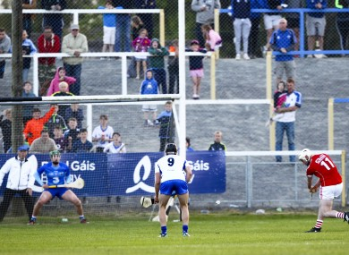Declan Dalton fires a late penalty to the net for Cork.