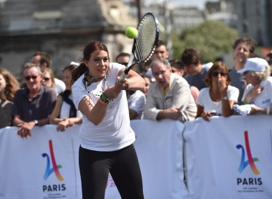 Marion Bartoli playing tennis on the Alexander III bridge near the Invalides in Paris on 24 June, 2017 in a bid to promote the candidacy of the city of Paris for the Summer Olympics Games in 2024.