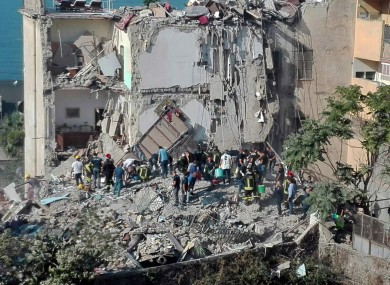 Rescuers work amid the rubble the collapsed building near Naples.