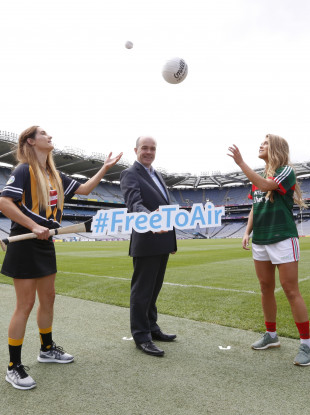 Minister for Communications, Climate Action and Environment, Denis Naughten TD at the photo-call with (LtoR) Miriam Frisby from Kilkenny Camogie and Sarah Rowe from Mayo Gaelic Football.