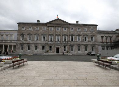 The man was taken from Leinster House by ambulance.