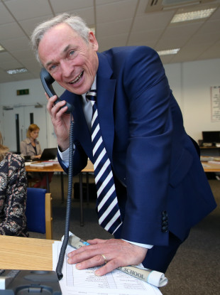 Minister Richard Bruton answering the phone at the National Parents Council Exam Helpline centre