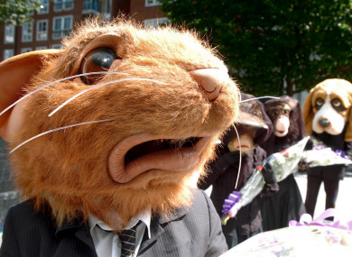 Members of the anti-animal experimentation group BUAV stage a mock funeral outside the Home Office in London, 2006.