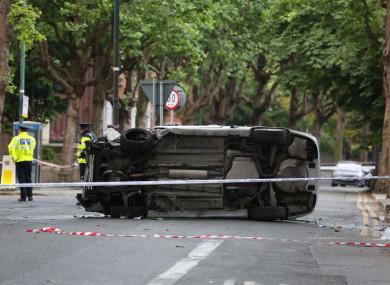 An overturned car on Adelaide Road in Dublin yesterday