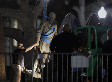 A statue of Confederate General Robert E Lee is removed from the University of Texas campus