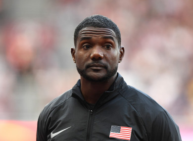 Justin Gatlin of the USA (gold) at the victory ceremony after the men's 100 m final at the IAAF World Championships in Athletics at the Olympic Stadium in London.