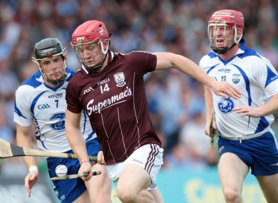 Waterford's Kevin Moran (left) and John Mullane chase Galway's Joe Canning in 2011.
