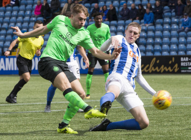 Forrest on fire: Iain Wilson tries to block Celtic man.