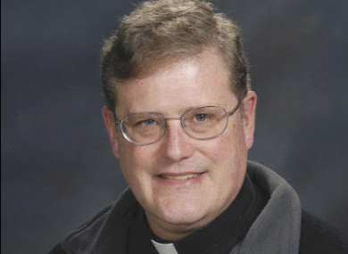 In this photo provided by the Catholic Diocese of Arlington, Va., is Father William Aitcheson, a priest in the Roman Catholic Diocese of Arlington.