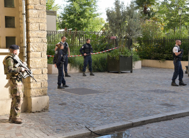 Police work near the scene where French soldiers were hit and injured by a vehicle.