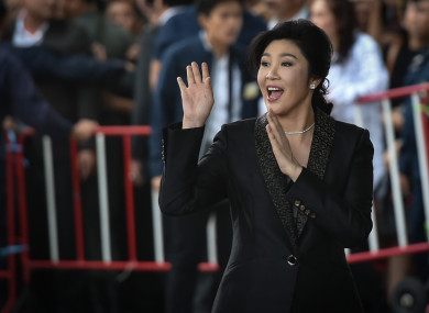 Former Thai Prime Minister Yingluck Shinawatra waves to supporters as she arrives at the Thai Supreme Court at the start of this month.