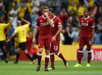 Liverpool captain Jordan Henderson looks dejected.