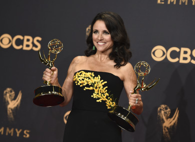 Julia Louis-Dreyfus poses in the press room with her awards at the Emmys on 17 September.