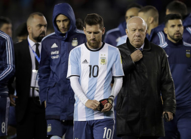 Argentina's Lionel Messi, centre, leaves the field at the end of the 2018 World Cup qualifying match against Venezuela.