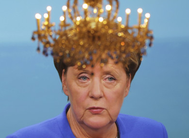 A well-placed chandelier in front of a TV screen showing last night's debate between Angela Merkel and her rival Martin Schulz