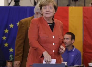 German Chancellor Angela Merkel casts her vote in Berlin.