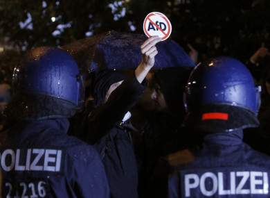 Police block demonstrators protesting against the nationalist 'Alternative for Germany', AfD, party in Berlin yesterday