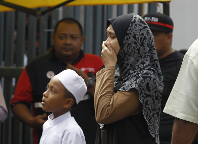 A woman cries outside the school.
