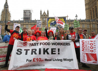 Supporters and workers from McDonald's restaurants in Cambridge and Crayford, SE London, during a rally at Old Palace Yard, London today.