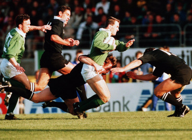 Furlong is tackled by the All Blacks.