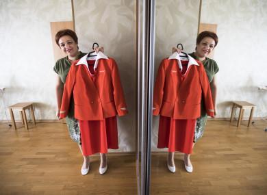 Aeroflot flight attendant Yevgeniya Magurina shows her uniform during an interview with the Associated Press