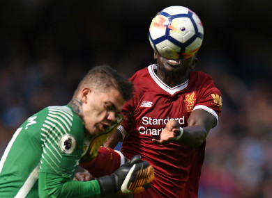 Sadio Mane challenges for the ball with Ederson.