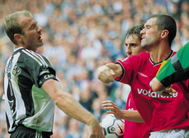 Keane taking a swing at Shearer (file pic).