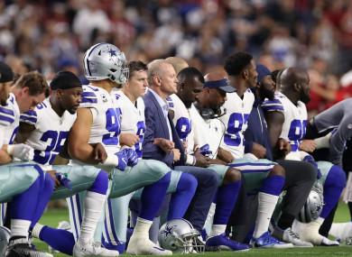 Cowboys kneeling before the US national anthem.