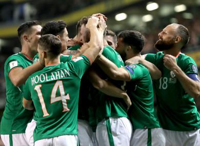 The Irish players mob goalscorer Murphy.