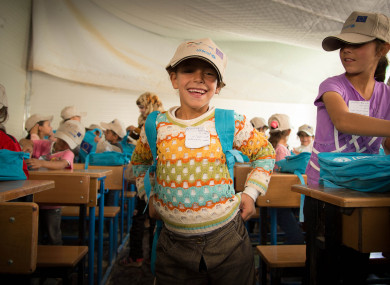 A Syrian refugee girl attending school during 2013's International Day of the Girl