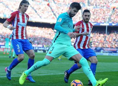 Atletico Madrid pair Filipe Luis and Koke with Gerard Pique of Barcelona