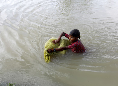 A child swimming across the border into Bangladesh