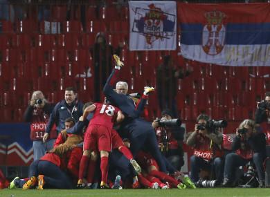 Serbia's Aleksandar Prijovic celebrates with his teammates.