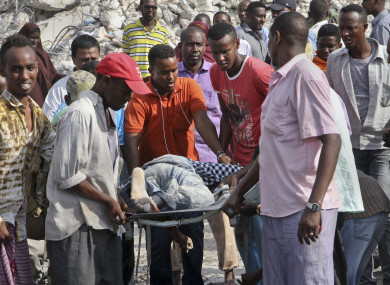 Somalis remove the body of a man killed in the blast.