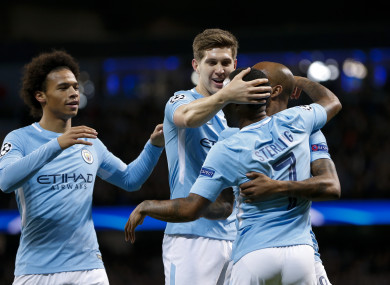 Man City players celebrate a goal during their midweek Champions League win over Napoli.