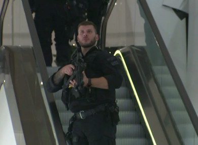 In this grab taken from video, an armed police officer patrols in Selfridges.