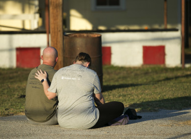 A couple comfort each other at a community centre in Sutherland Springs
