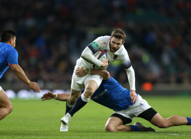 England's Elliot Daly (centre) and Samoa's Kieron Fonotia (right) compete for the ball.