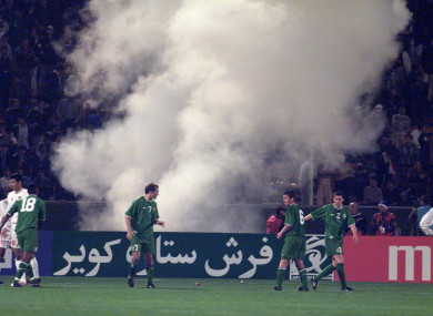 Someone lets off a flare in the crowd during the Iran-Ireland World Cup play-off game in November 2001.