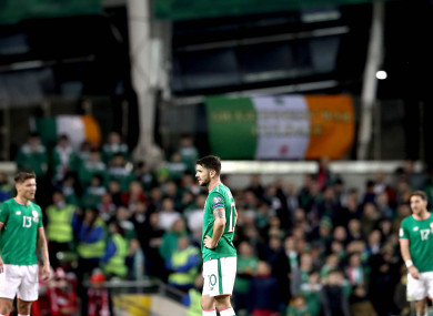 Ireland's Jeff Hendrick and Robbie Brady dejected after conceding a third goal.