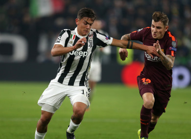 Juventus Paulo Dybala and Barcelona's Lucas Digne battle for the ball.