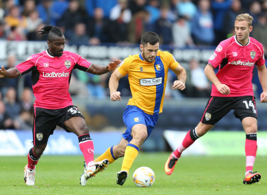 Hoban (centre) most recently played for Mansfield Town.