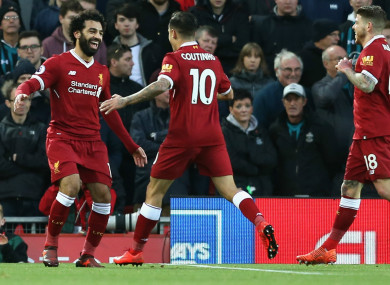Mohamed Salah (L) celebrates with Liverpool team-mates