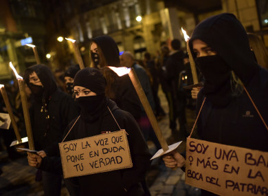 Demonstrators hold up signs reading,''I'm the voice that calls into question your truth'' during a march to mark International Day against male violence, in Pamplona.
