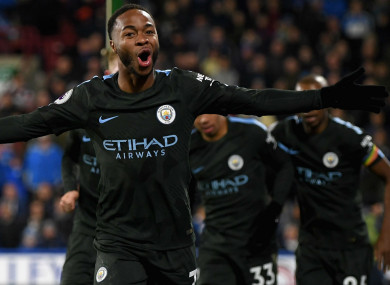 Raheem Sterling celebrates Manchester City's winner against Huddersfield Town.