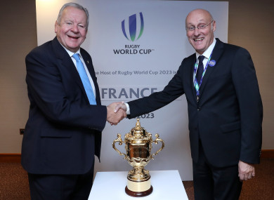 World Rugby Chairman Bill Beaumont shakes hands with Bernard Laporte, FFR President.