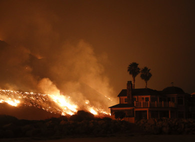 A wildfire threatens homes as it burns along the 101 Freeway in Ventura, California.