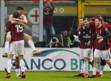 Patrick Cutrone celebrates his goal with his AC Milan team-mates.